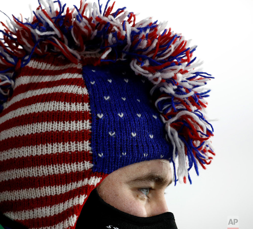 A United States fan watches the men's 12.5-kilometer biathlon pursuit at the 2018 Winter Olympics in Pyeongchang, South Korea, Monday, Feb. 12, 2018. (AP Photo/Charlie Riedel)