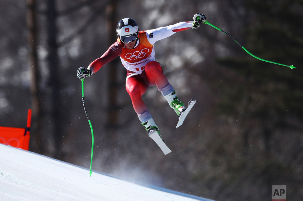 Switzerland's Justin Murisier skis during the downhill portion of the men's combined at the 2018 Winter Olympics in Jeongseon, South Korea, Tuesday, Feb. 13, 2018. (AP Photo/Alessandro Trovati)