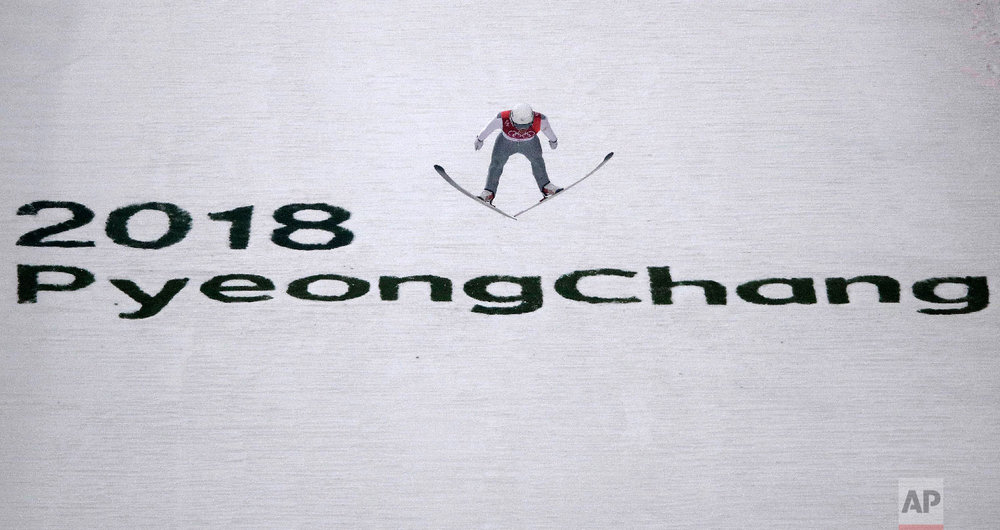 Ondrej Pazout, of the Czech Republic, jumps during the trial jump of the nordic combined at the 2018 Winter Olympics in Pyeongchang, South Korea, Wednesday, Feb. 14, 2018. (AP Photo/Charlie Riedel)