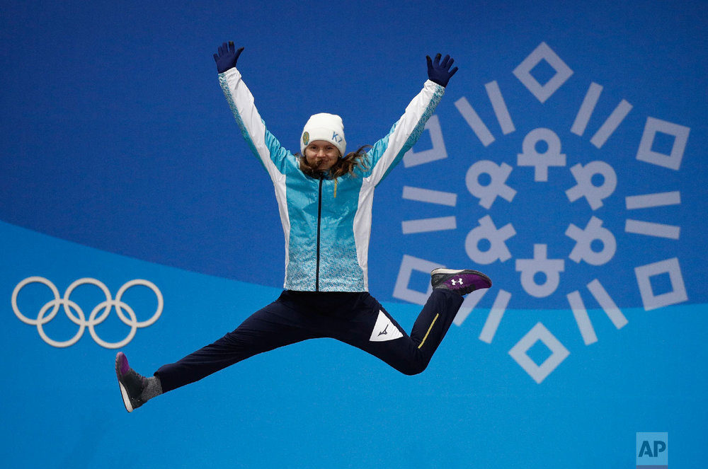 Women's moguls bronze medalist Yulia Galysheva, of Kazakhstan, celebrates during the medals ceremony at the 2018 Winter Olympics in Pyeongchang, South Korea, Monday, Feb. 12, 2018. (AP Photo/Jae C. Hong)