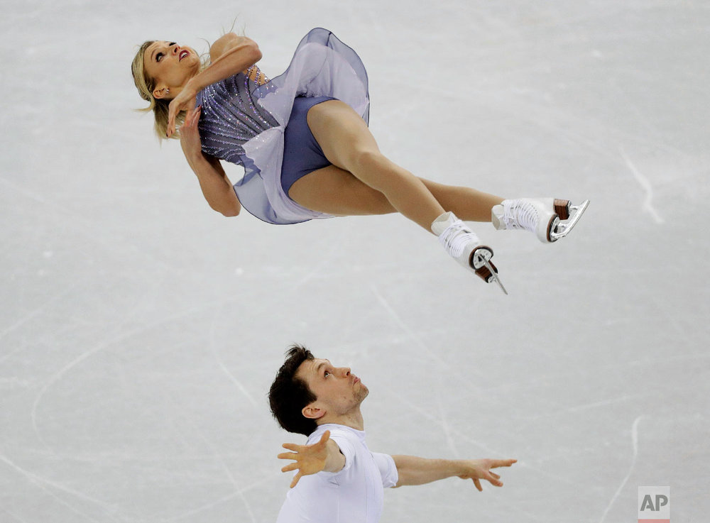 Kirsten Moore-Towers and Michael Marinaro, of Canada, perform in the pairs free skate figure skating final in the Gangneung Ice Arena at the 2018 Winter Olympics in Gangneung, South Korea, Thursday, Feb. 15, 2018. (AP Photo/David J. Phillip)