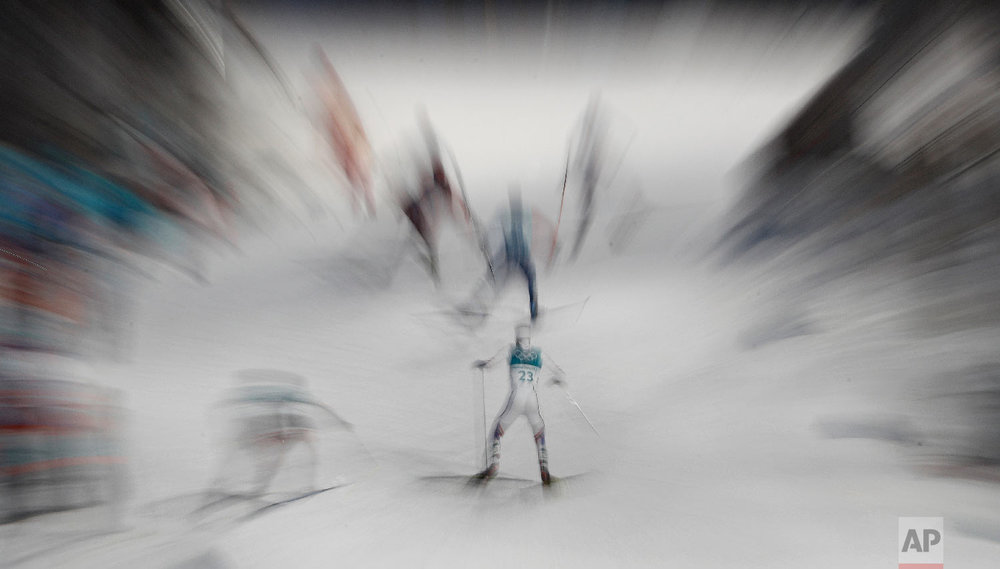 Joergen Graabak, of Norway, and other athletes climbed a hill during the 10km cross-country skiing portion of the nordic combined event at the 2018 Winter Olympics in Pyeongchang, South Korea, Wednesday, Feb. 14, 2018. (AP Photo/Charlie Riedel)