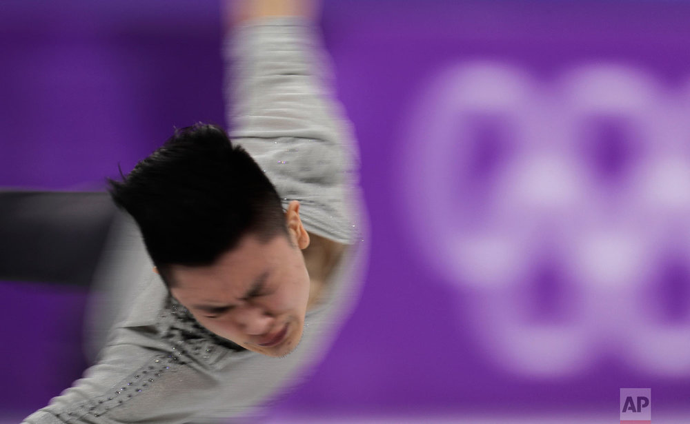 Yan Han of China performs during the men's short program figure skating in the Gangneung Ice Arena at the 2018 Winter Olympics in Gangneung, South Korea, Friday, Feb. 16, 2018. (AP Photo/Julie Jacobson)