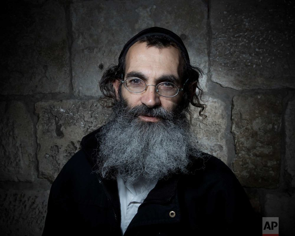 In this Sunday, Feb. 11, 2018 photo, Amos Finish an Ultra-Orthodox Jew, poses for a portrait in Jerusalem's Old City. (AP Photo/Oded Balilty)
