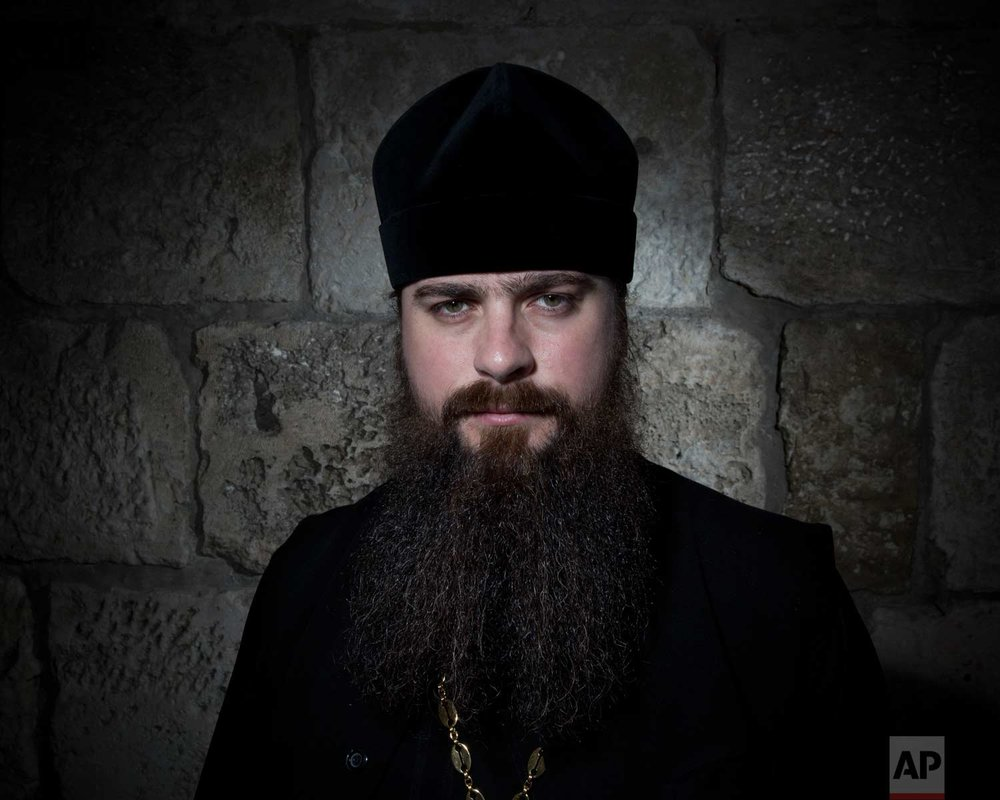 In this Sunday, Feb. 11, 2018 photo, Russian priest George Olhovic poses for a portrait in Jerusalem Old City. (AP Photo/Oded Balilty)