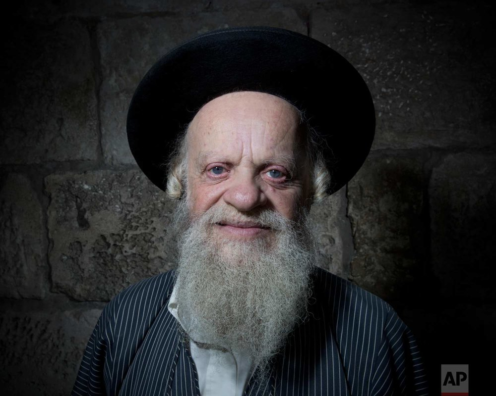 In this Sunday, Feb. 11, 2018 photo, Efraim Grois, a Jewish Ultra-Orthodox poses for a portrait in Jerusalem's Old City. (AP Photo/Oded Balilty)
