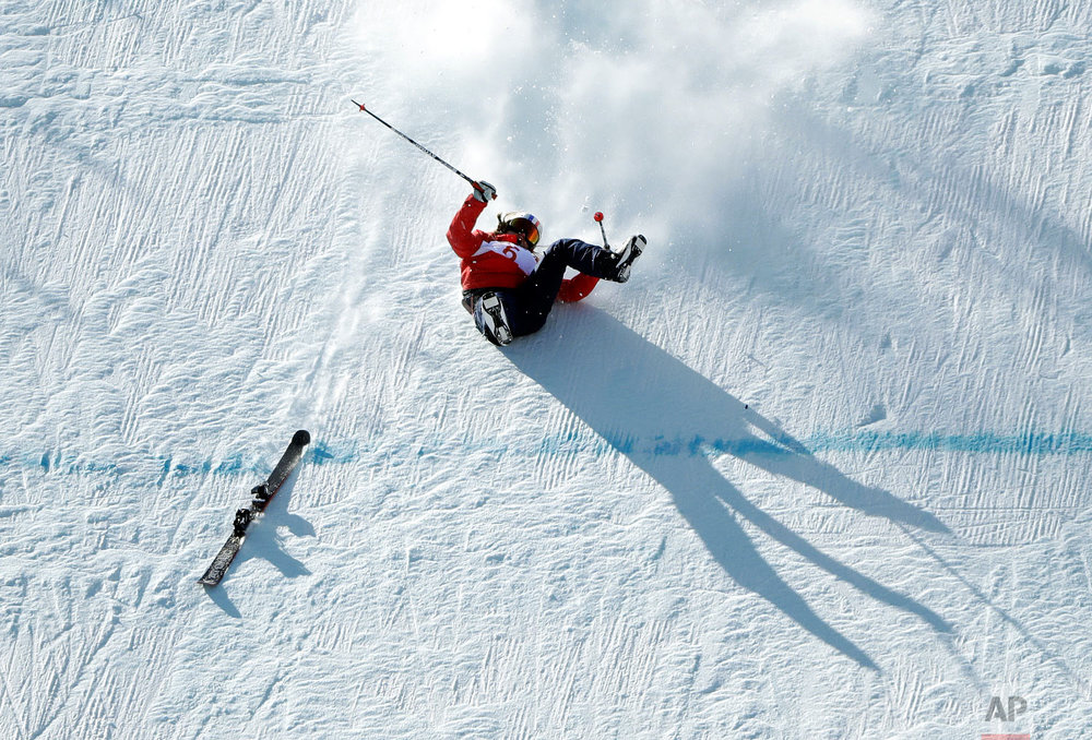 Tess Ledeux, of France, crashes during the women's slopestyle qualifying at Phoenix Snow Park at the 2018 Winter Olympics in Pyeongchang, South Korea, Saturday, Feb. 17, 2018. (AP Photo/Gregory Bull)