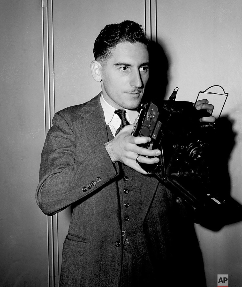 AP staff photographer Max Desfor poses with a press camera in 1939. Desfor received the 1951 Pulitzer Prize for Photography for his coverage of the Korean War. (AP Photo)