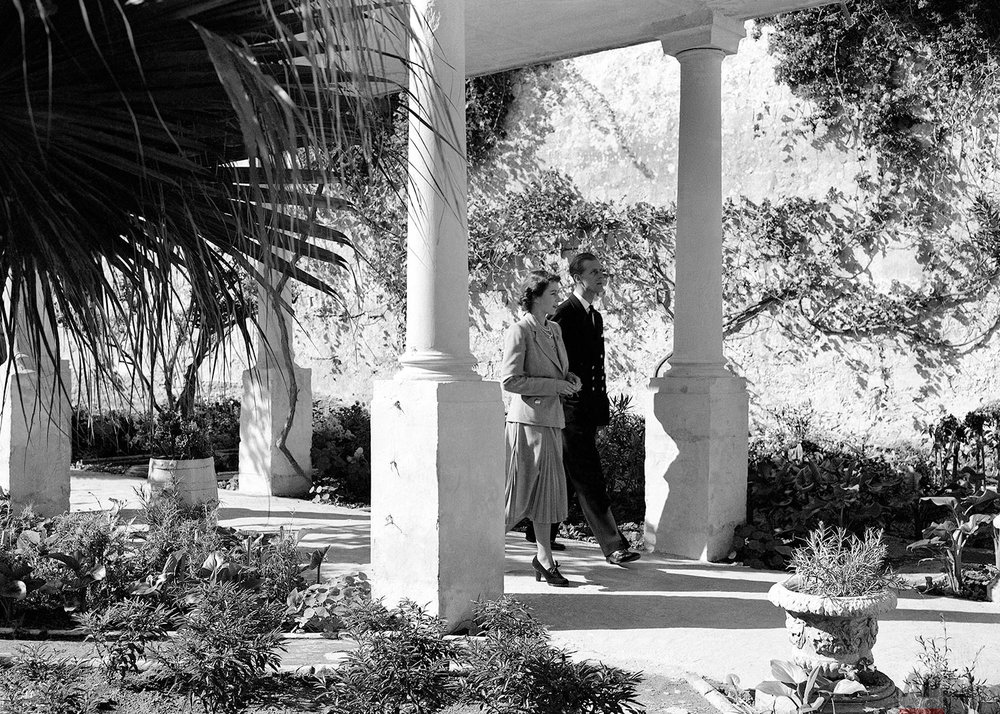 "Princess Elizabeth and her husband, Philip, Duke of Edinburgh, are seen strolling in the gardens of the Villa Guardamangia, Malta on Nov. 23, 1949. The Princess is residing at the Villa during her stay in the island to visit her husband. The Duke of Edinburgh is First Lieutenant aboard the destroyer ""Chequers"" presently refitting at Malta. (AP Photo/Max Desfor)"