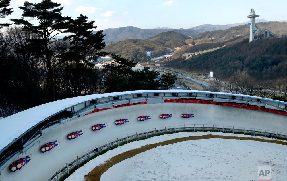In this multiple exposure photo, Marek Solcansky and Karol Stuchlak, of Slovakia, take a practice run during the men's doubles luge training at the 2018 Winter Olympics in Pyeongchang, South Korea, Monday, Feb. 12, 2018. (AP Photo/Charlie Riedel)