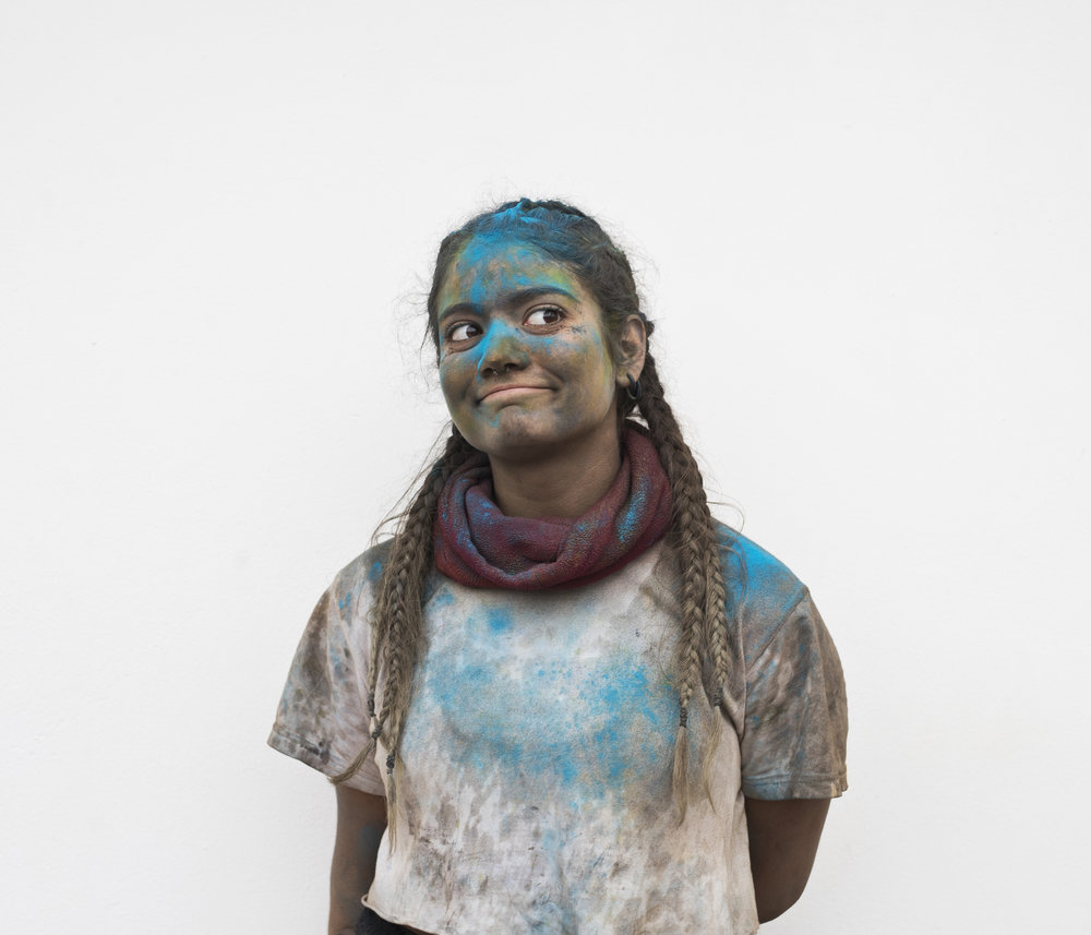 In this Monday, Feb. 19, 2018 photo Athanasia Vasilaki 15, poses for a portrait as she takes part in the flour war, a unique colorful flour fight marking the end of the carnival season in the port town of Galaxidi, some 200 kilometers (120 miles) west of Athens. (AP Photo/Petros Giannakouris)