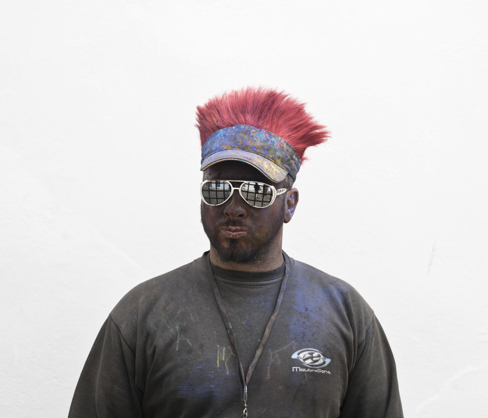 In this Monday, Feb. 19, 2018 photo Eleftherios Fogianos 35, poses for a portrait as he takes part in the flour war, a unique colorful flour fight marking the end of the carnival season in the port town of Galaxidi, some 200 kilometers (120 miles) west of Athens. (AP Photo/Petros Giannakouris)