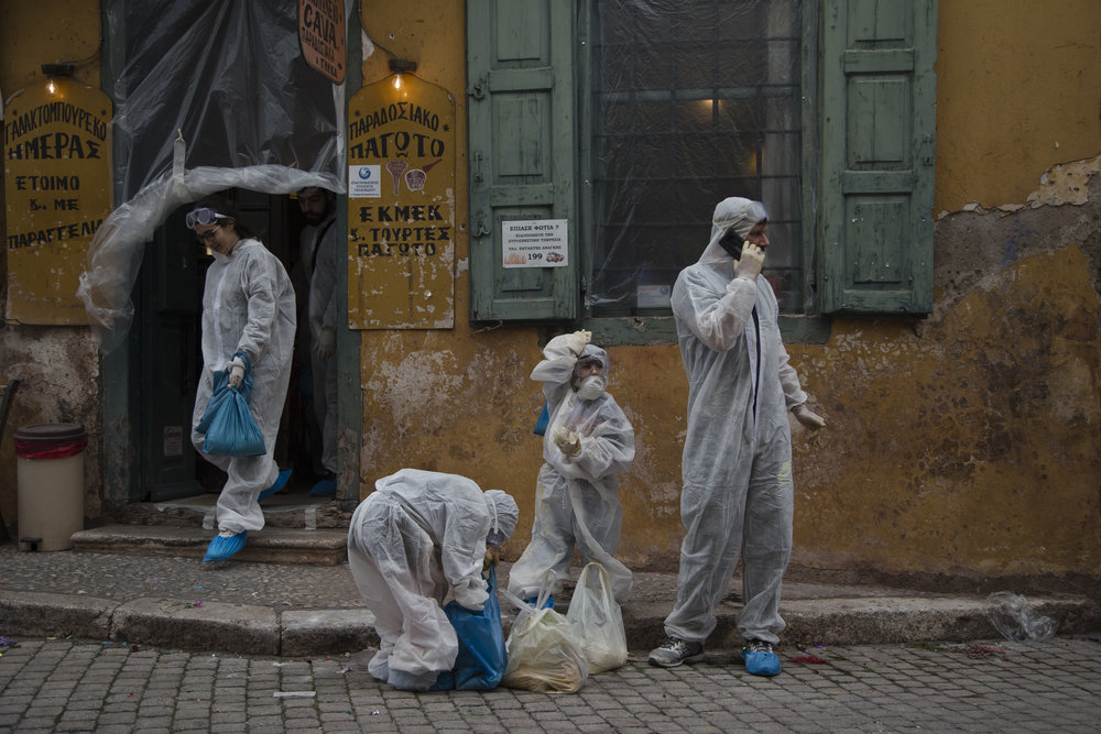 In this Monday, Feb. 19, 2018 photo, people gather to participate in the flour war, a unique colorful flour fight marking the end of the carnival season in the port town of Galaxidi, some 200 kilometers (120 miles) west of Athens.  (AP Photo/Petros Giannakouris)