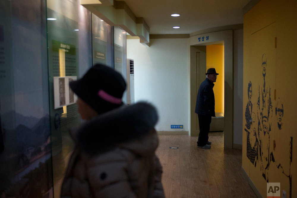Visitors tour the villa known as Hwajinpo Castle, once a holiday home for late North Korea founder Kim Il Sung, at Hwajinpo Beach, South Korea, Monday, Feb. 19, 2018. (AP Photo/Jae C. Hong)