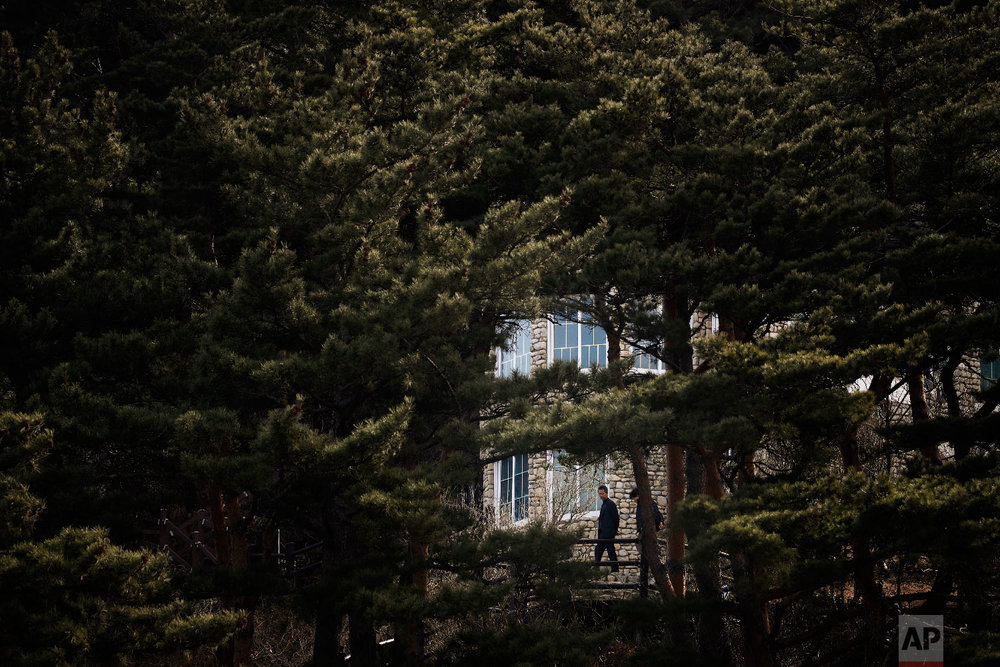 Surrounded by pine trees, visitors tour the villa known as Hwajinpo Castle, once a holiday home for late North Korea founder Kim Il Sung, at Hwajinpo Beach, South Korea, Monday, Feb. 19, 2018. (AP Photo/Jae C. Hong)