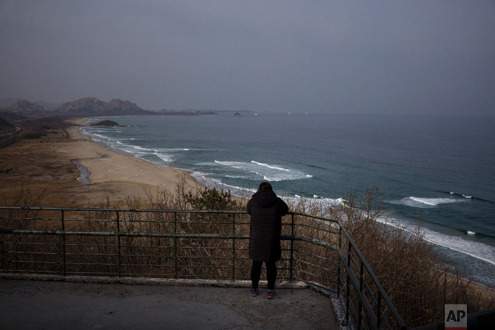 Park Range, 45, leans on a rail while viewing North Korea from the Goseong Unification Observatory in Goseong, South Korea, Monday, Feb. 19, 2018. (AP Photo/Jae C. Hong)