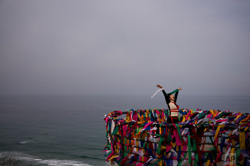 Artist Doyu, 48, performs at the Goseong Unification Observatory as part of an art festival in Goseong, South Korea, Monday, Feb. 19, 2018. (AP Photo/Jae C. Hong)