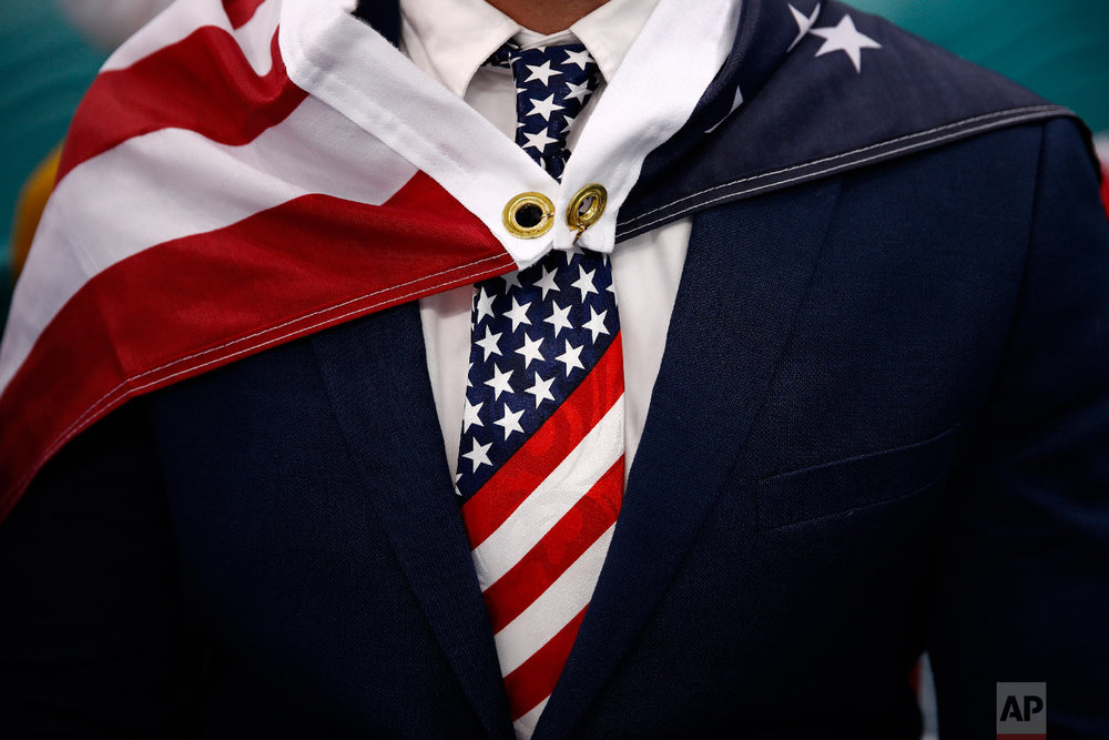 Patrick Kearney wears an American flag as a cape during the quarterfinal round of the men's hockey game between the United States and the Czech Republic at the 2018 Winter Olympics in Gangneung, South Korea, Wednesday, Feb. 21, 2018. (AP Photo/Jae C. Hong)