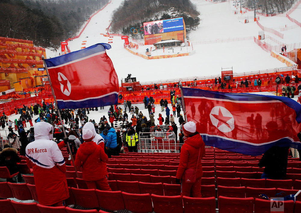 North Korean fans wave flags at the women's slalom at Yongpyong alpine center at the 2018 Winter Olympics in Pyeongchang, South Korea, Wednesday, Feb. 14, 2018. (AP Photo/Christophe Ena)