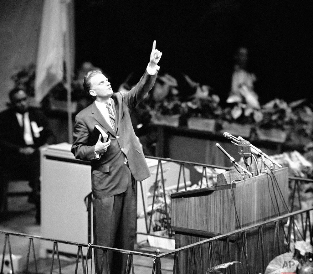"Evangelist Billy Graham is shown speaking at Madison Square Garden, New York City  May 15, 1957 as he opens his crusade for ""A Spiritual Revolution in the City."" (AP Photo)"