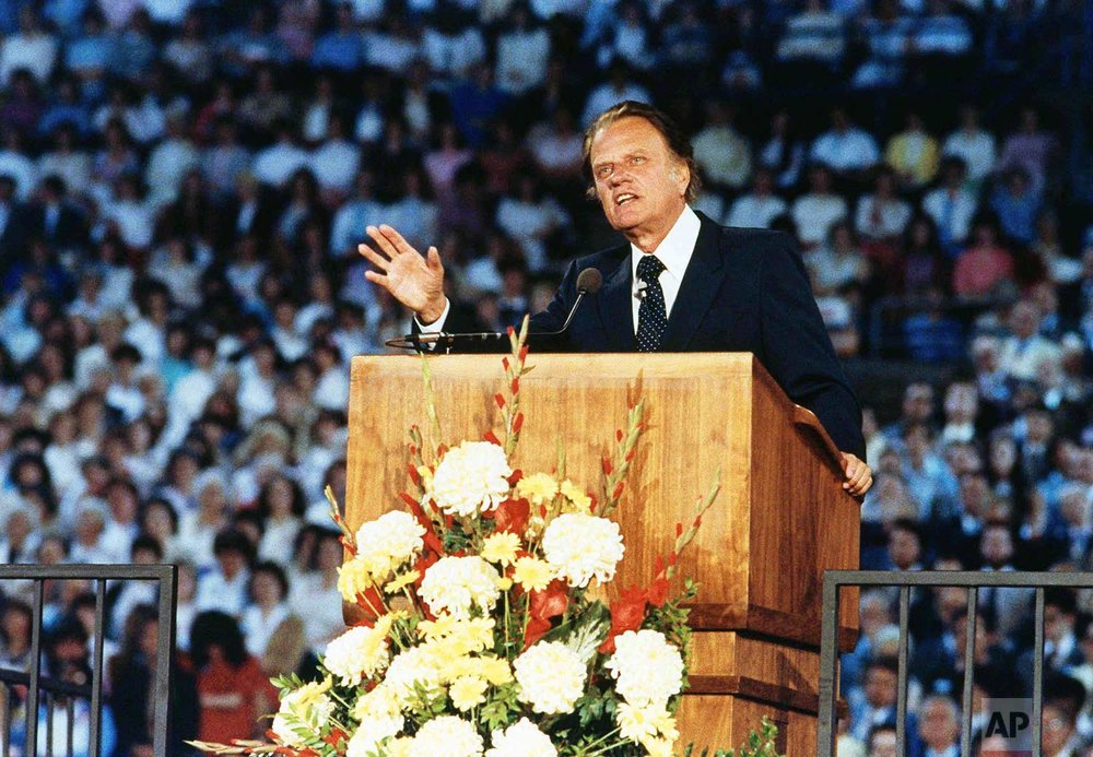 Rev. Billy Graham is shown preaching to 24,000 people in Tacoma's New Dome Stadium, May 16, 1983, Tacoma, Wash. (AP Photo/Dave Ekren)