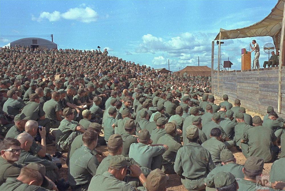 Evangelist Billy Graham speaks a crowd of more than 5,000 U.S. troops at Long Binh, Vietnam, December 23, 1966. (AP Photo)