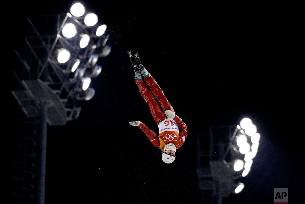 Russian athlete Liubov Nikitina jumps during the women's freestyle aerial final at Phoenix Snow Park at the 2018 Winter Olympics in Pyeongchang, South Korea, Friday, Feb. 16, 2018. (AP Photo/Kin Cheung)