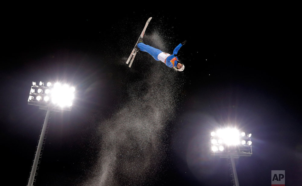 Kiley McKinnon, of the United States, warms up prior to the women's freestyle aerial final at Phoenix Snow Park at the 2018 Winter Olympics in Pyeongchang, South Korea, Friday, Feb. 16, 2018. (AP Photo/Lee Jin-man)