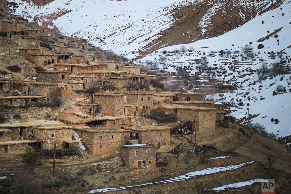 In this Wednesday, Feb. 14, 2018 photo, a Berber village, Tighanmin, is surrounded by snow covered mountains in the Middle Atlas, near Azilal, central Morocco. (AP Photo/Mosa'ab Elshamy)