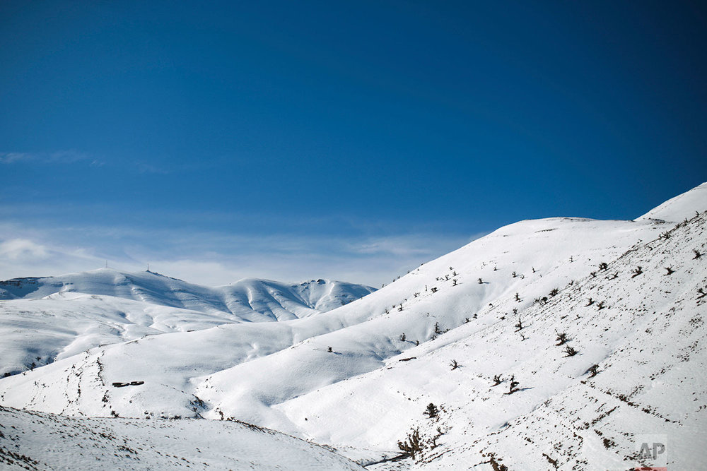 In this Thursday, Feb. 15, 2018 photo, a view of snow covered mountains in the Middle Atlas village of Tighanmin, near Azilal, central Morocco. (AP Photo/Mosa'ab Elshamy)
