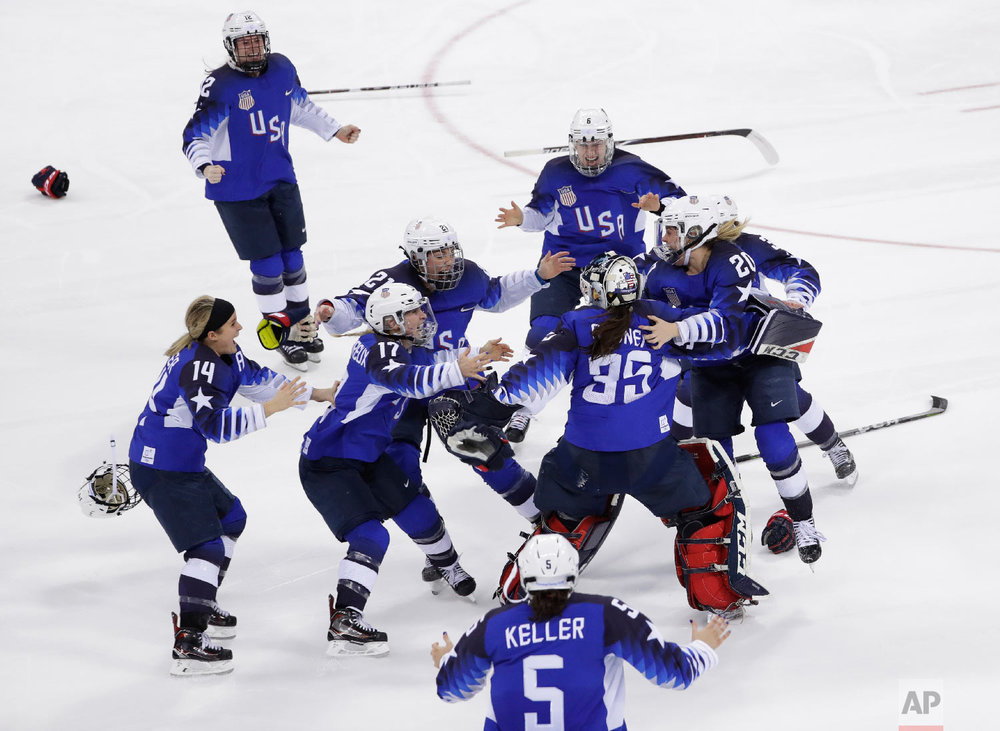 United States celebrates winning gold in the women's gold medal hockey game.