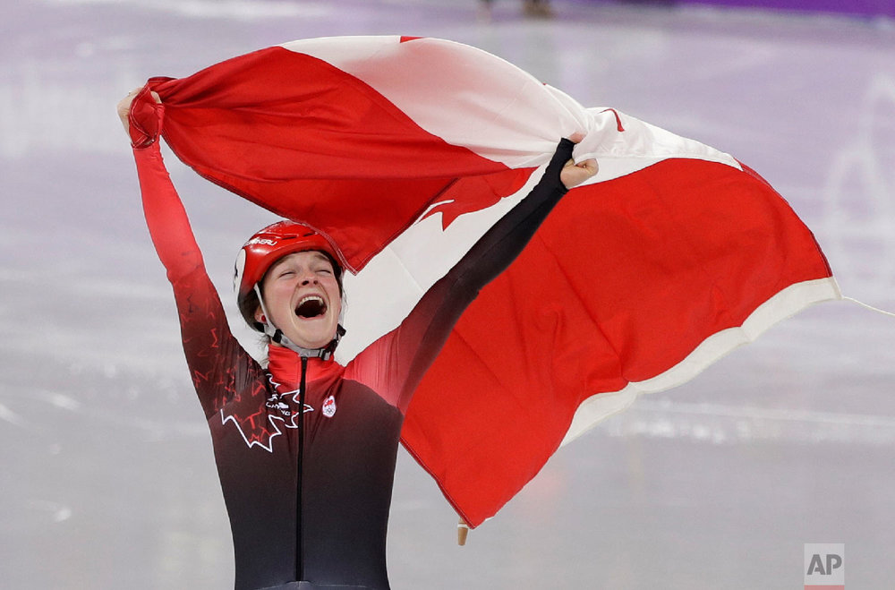 Kim Boutin of Canada celebrates after winning the bronze medal in the women's 1500 meters short track speedskating final in the Gangneung Ice Arena at the 2018 Winter Olympics in Gangneung, South Korea, Saturday, Feb. 17, 2018. (AP Photo/David J. Phillip)