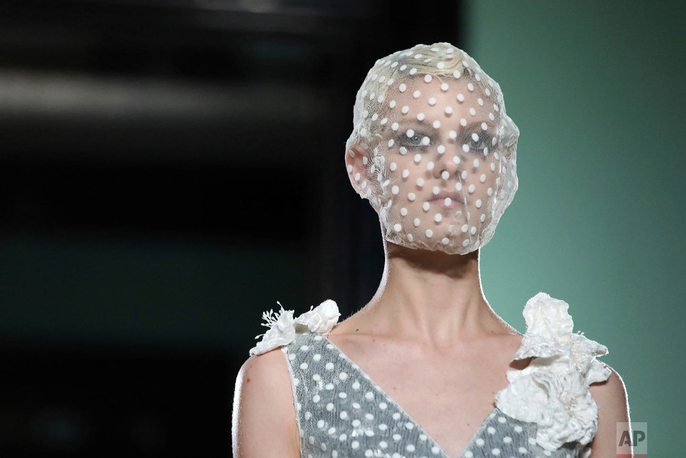 A Model wears a creation by Erdem at the Autumn/Winter 2018 runway show in London, Monday, Feb. 19, 2018. (Photo by Grant Pollard/Invision/AP)