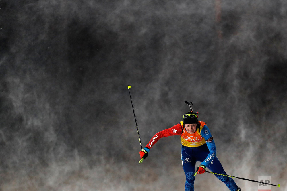 Justine Braisaz, of France skis during the women's 4x6-kilometer relay biathlon at the 2018 Winter Olympics in Pyeongchang, South Korea, Thursday, Feb. 22, 2018. (AP Photo/Andy Wong)