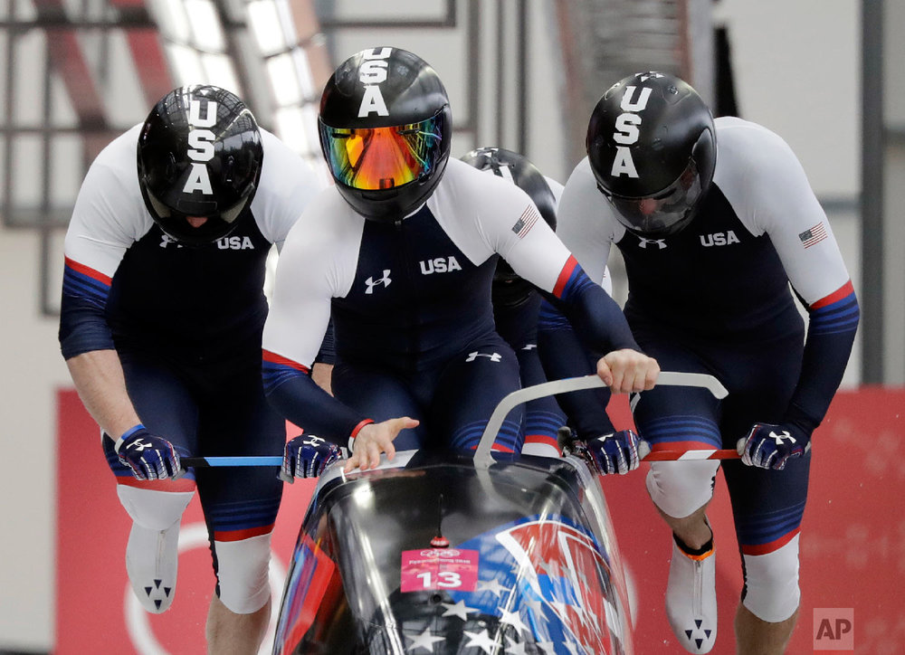 Driver Codie Bascue, Steven Langton, Samuel Mc Guffie and Evan Weinstock of the United States start their heat on the first day of four-man bobsled competition at the 2018 Winter Olympics in Pyeongchang, South Korea, Saturday, Feb. 24, 2018. (AP Photo/Wong Maye-E)