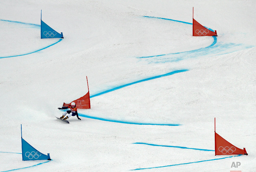 Gloria Kotnik, of Slovenia, runs the course during the women's parallel giant slalom qualification run at Phoenix Snow Park at the 2018 Winter Olympics in Pyeongchang, South Korea, Saturday, Feb. 24, 2018. (AP Photo/Lee Jin-man)