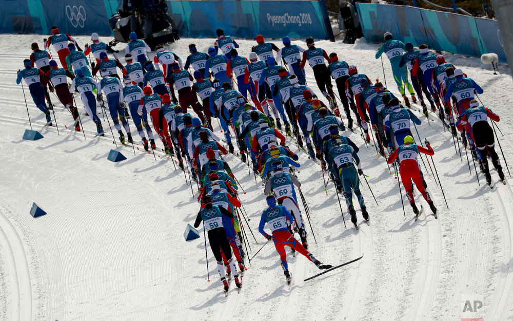 Competitors start the men's 50k cross-country skiing race at the 2018 Winter Olympics in Pyeongchang, South Korea, Saturday, Feb. 24, 2018.(AP Photo/Matthias Schrader)