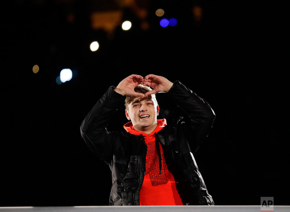 DJ Martin Garrix from the Netherlands gestures during the closing ceremony of the 2018 Winter Olympics in Pyeongchang, South Korea, Sunday, Feb. 25, 2018. (AP Photo/Kirsty Wigglesworth)