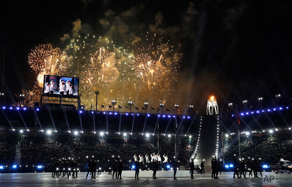 Fireworks explode as EXO performs during the closing ceremony of the 2018 Winter Olympics in Pyeongchang, South Korea, Sunday, Feb. 25, 2018. (AP Photo/Natacha Pisarenko)