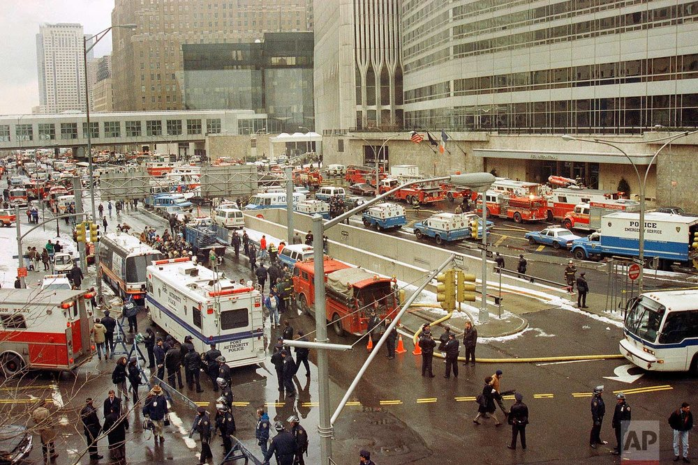 In this Feb. 26, 1993 photo, emergency vehicles and personnel fill New York's West Street following an underground explosion that rocked the World Trade Center. It was a terror attack that foreshadowed Sept. 11: the deadly World Trade Center bombing that happened 25 years ago Monday. (AP Photo/Betsy Herzog)