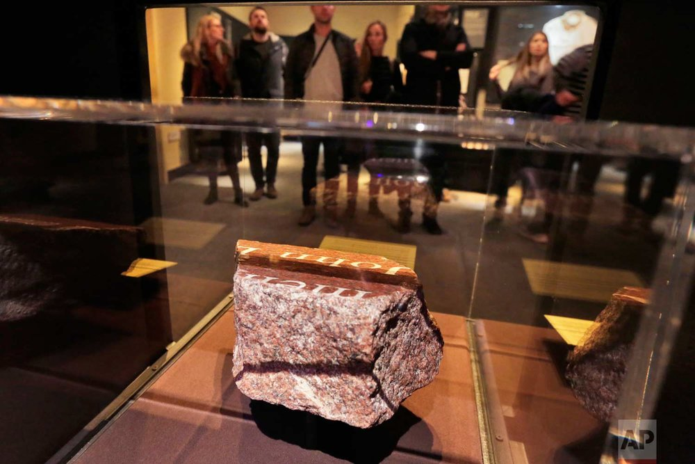 A fragment of a memorial fountain, that was constructed after Feb. 26, 1993 truck bomb attack at the World Trade Center and was destroyed on Sept. 11, 2001, is displayed at the National September 11 Museum, in New York, Friday, Feb. 23, 2018. It was a terror attack that foreshadowed Sept. 11: the deadly World Trade Center bombing that happened 25 years ago Monday. (AP Photo/Richard Drew)