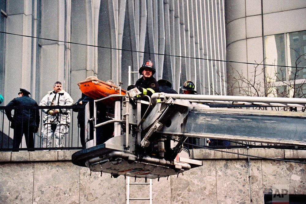 In this Feb. 26, 1993 photo, firefighters remove a victim on a gurney outside one of the World Trade Center's twin towers in New York, after a car bomb in an underground garage rocked the complex. (AP Photo/Alex Brandon)
