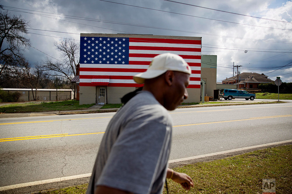 An American flag decorates a building in Monroe, Ga., in rural Walton County, Thursday, Feb. 22, 2018. (AP Photo/David Goldman)