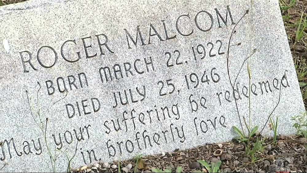 This July 26, 2014, photo shows the gravesite of Roger Malcom in Rutledge, Georgia.  (AP Photo/Alex Sanz)
