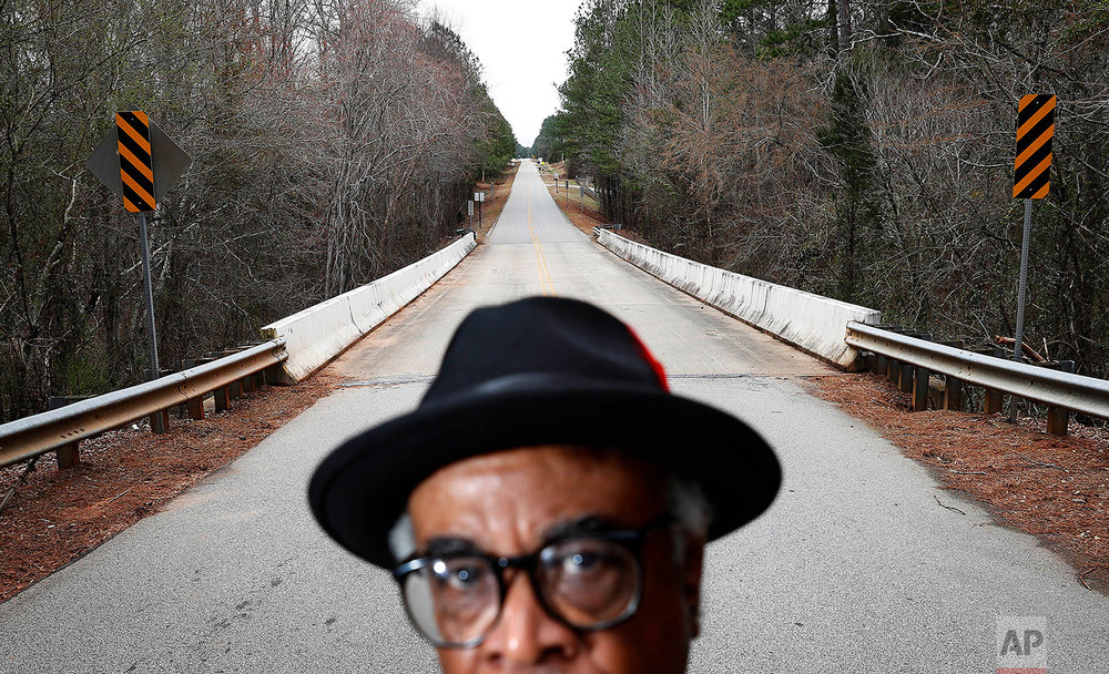 "In this Feb. 22, 2018 photo, Tyrone Brooks, a veteran civil rights activist, stands near the spot along the rural Moore's Ford Road where in 1946 two young black couples were stopped by a white mob and shot multiple times in Monroe, Ga. Even if no one is ultimately prosecuted for the deaths of Roger and Dorothy Malcom and George and Mae Murray Dorsey, it's important to know what happened and who was involved, said Brooks. Nonetheless, he said the closure of the investigations won't stop him. ""Our resolve is as strong as it's ever been,"" Brooks said. (AP Photo/David Goldman)"