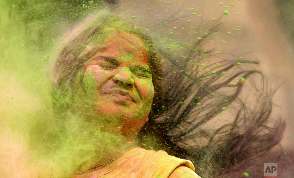 Holi celebrated in Mumbai, India, March. 2, 2018.  (AP Photo/Rajanish Kakade)