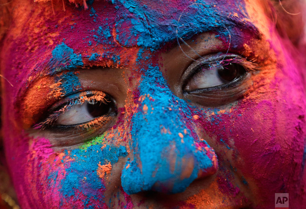 A women celebrates the Hindu festival of colors in Kolkata, India, March 1, 2018. (AP Photo/Bikas Das)