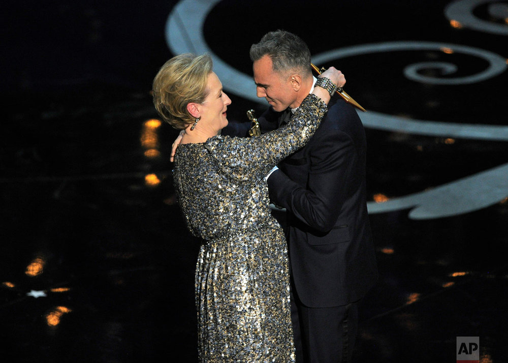 "Meryl Streep, left, presents the award for best actor in a leading role to Daniel Day-Lewis for ""Lincoln"" during the Oscars at the Dolby Theatre on Sunday Feb. 24, 2013, in Los Angeles.  (Photo by Chris Pizzello/Invision/AP)"