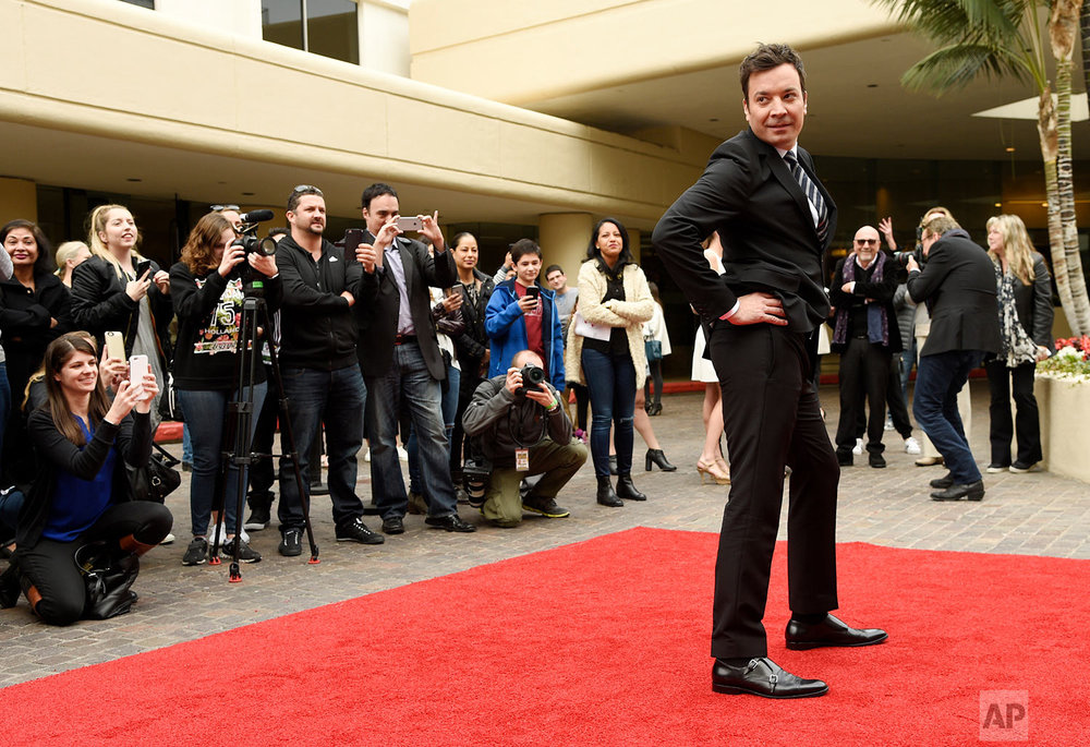 Jimmy Fallon, host of the 74th Annual Golden Globe Awards, strikes a pose after rolling out the red carpet during Golden Globe Awards Preview Day at the Beverly Hilton on Wednesday, Jan. 4, 2017, in Beverly Hills, Calif. The awards will be held on Sunday. (Photo by Chris Pizzello/Invision/AP)