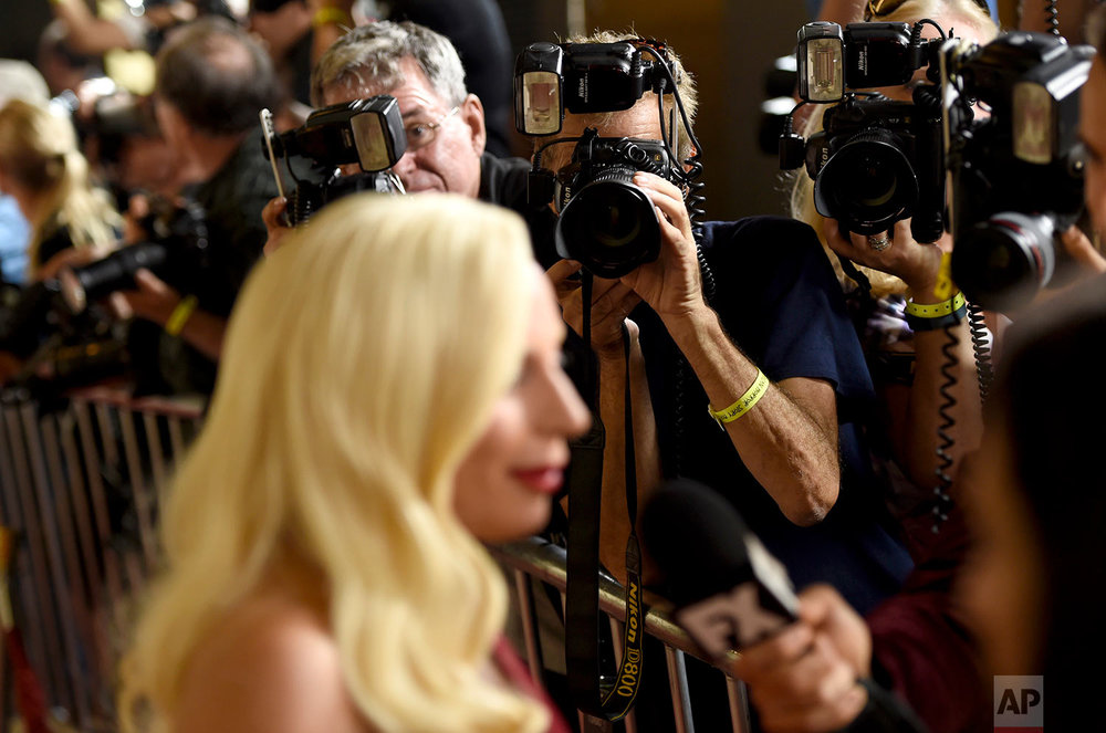 "Lady Gaga participates in an interview as she arrives at the Los Angeles premiere screening of ""American Horror Story: Hotel"" at Regal Cinemas L.A. Live on Saturday, Oct. 3, 2015. (Photo by Chris Pizzello/Invision/AP)"